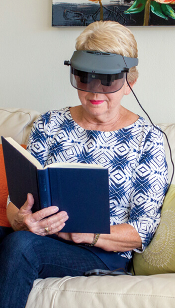 reading book with acesight electronic glasses for low vision and blind